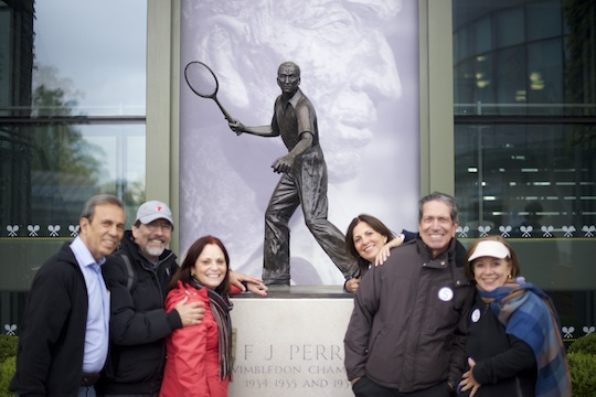 a London Magical Tours group admiring the Fred Perry Statue during a visit to the Wimbledon Lawn Tennis Grounds